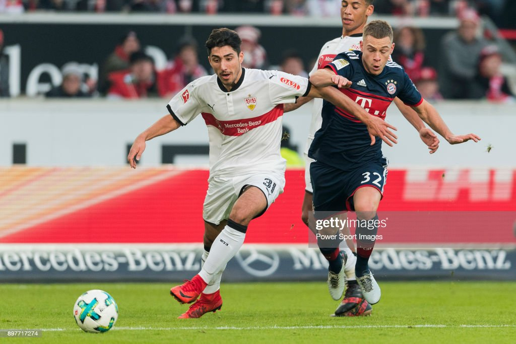 Midfielder Joshua Kimmich #32 of FC Bayern Muenchen and Berkay Ozcan #31 of VfB Stuttgart during the Bundesliga match between VfB Stuttgart and FC Bayern Muenchen at the Mercedes-Benz Arena on December 16, 2017 in Stuttgart, Germany.