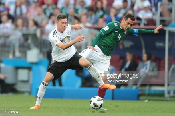 midfielder Julian Draxler of Germany and defender Rafael Marquez of Mexico battle for the ball during a Group F 2018 FIFA World Cup soccer match...