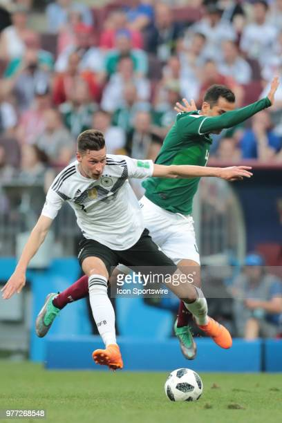 midfielder Julian Draxler of Germany is tackled from behind by defender Rafael Marquez of Mexico during a Group F 2018 FIFA World Cup soccer match...