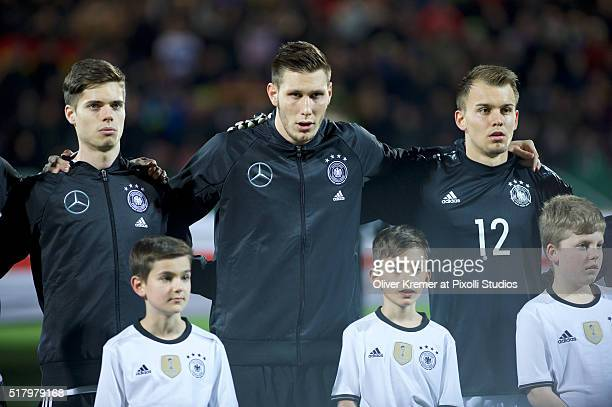Midfielder Julian Weigl of Germany Defense Niklas Suele of Germany and Goal Keeper Timon Wellenreuther of Germany during the national anthem at...