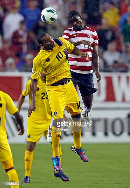 Midfielder Keiran Murtagh of Team Antigua and Barbuda heads the ball as midfielder Maurice Edu of Team USA defends during the FIFA World Cup...