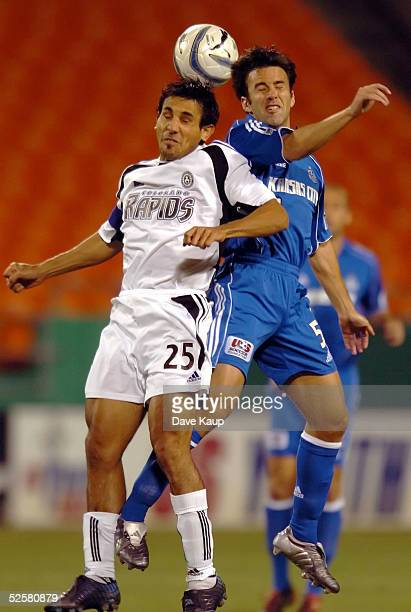 Midfielder Kerry Zavagnin of the Kansas City Wizards and midfielder Pablo Mastroeni of the Colorado Rapids meet in a header during the first half of...