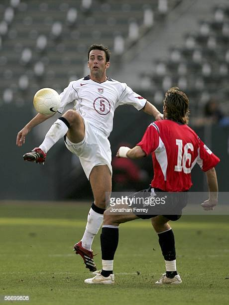 Midfielder Kerry Zavagnin of the USA kicks the ball against Magne Hoset of Norway during an international friendly match on January 29 2006 at The...