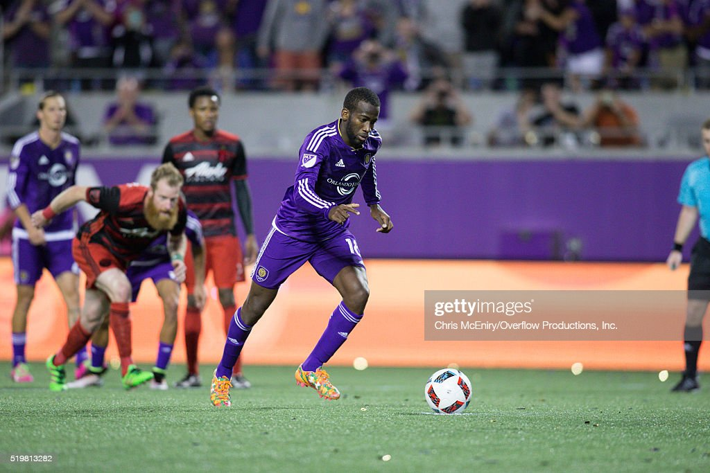 Midfielder Kevin Molino #18 of Orlando City SC takes the penalty kick scoring the 4th and final goal of a 4-1 match against the Portland Timbers at Citrus Bowl on April 3, 2016 in Orlando, Florida.