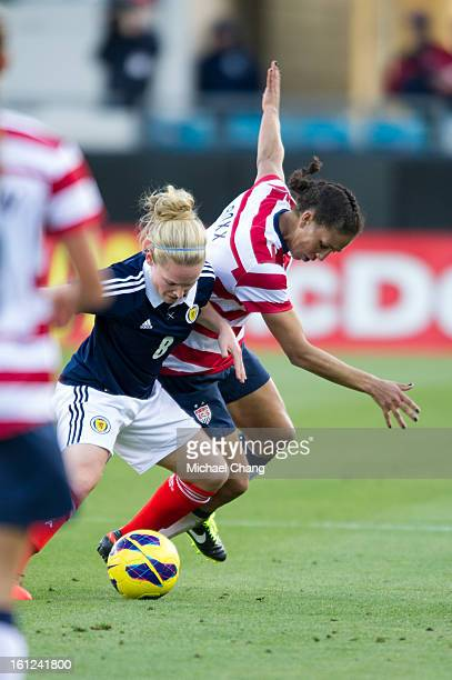 Midfielder Kim Little of Scotland and midfielder Shannon Boxx of the United States battle for a ball at EverBank Field on February 9 2013 in...
