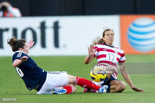 Midfielder Kim Little of Scotland and midfielder Tobin Heath of the United States collide while attempting to get a ball at EverBank Field on...