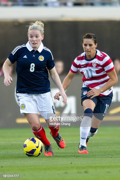 Midfielder Kim Little of Scotland maneuvers by defender Ali Krieger of the United States at EverBank Field on February 9 2013 in Jacksonville Florida...