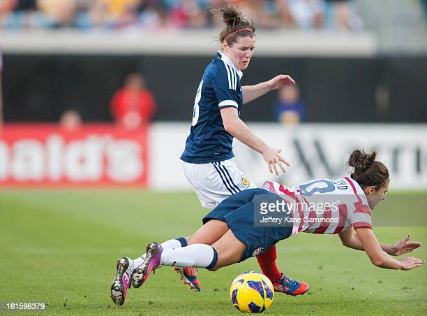 Midfielder Kim Little of Scotland trips up Midfielder Carli Lloyd of the United States during the game at EverBank Field on February 9 2013 in...