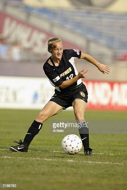 Midfielder Krista Davey of the New York Power controls the ball during the WUSA game against the San Jose CyberRays at Mitchel Athletic Complex on...