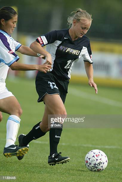 Midfielder Krista Davey of the New York Power dribbles the ball against the Atlanta Beat during the WUSA game on July 13 2002 at Mitchell Field in...