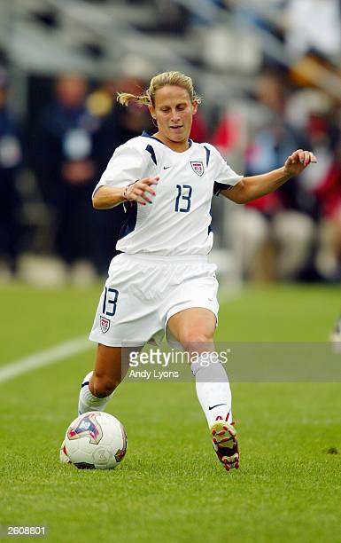 Midfielder Kristine Lilly of the USA dribbles the ball against North Korea during the 2003 FIFA Women's World Cup at Crew Stadium on September 28,...