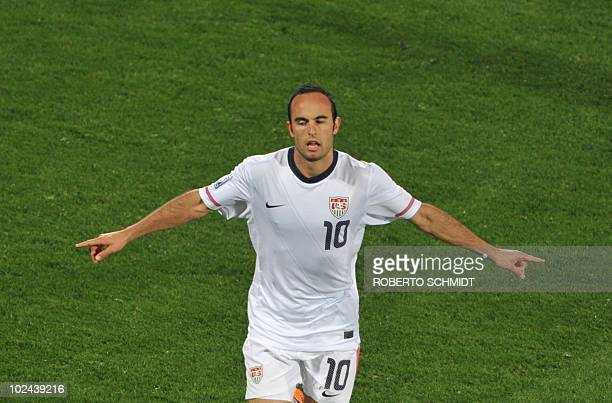 US midfielder Landon Donovan celebrates after scoring a penalty during the 2010 World Cup round of 16 football match USA vs Ghana on June 26 2010 at...