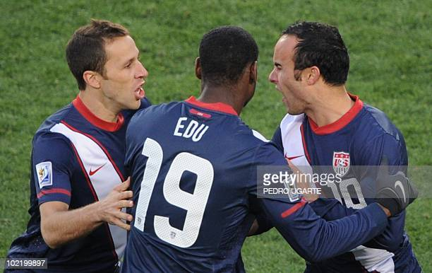 US midfielder Landon Donovan celebrates with US defender Carlos Bocanegra and US midfielder Maurice Edu after scoring during the Group C first round...