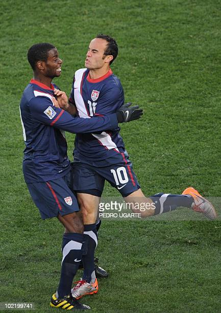 US midfielder Landon Donovan celebrates with US midfielder Maurice Edu after scoring during the Group C first round 2010 World Cup football match...