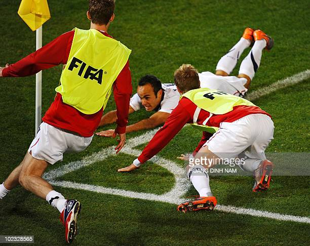 US midfielder Landon Donovan is joined by teammates as he celebrates his goal during the Group C first round 2010 World Cup football match USA vs...