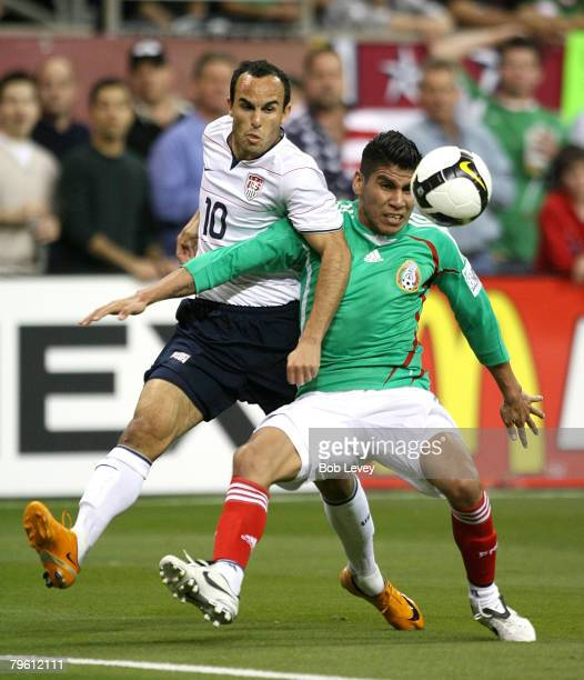 Midfielder Landon Donovan of the USA MNT battles Carlos Salcido of Mexico for the ball February 6 2008 at Reliant Stadium in Houston Texas USA and...