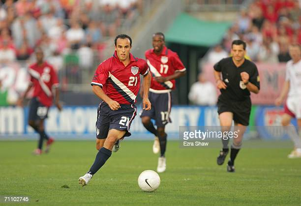 Midfielder Landon Donovan of the USA takes the ball downfield during the game against Latvia at Rentschler Field on May 28, 2006 in East Hartford,...