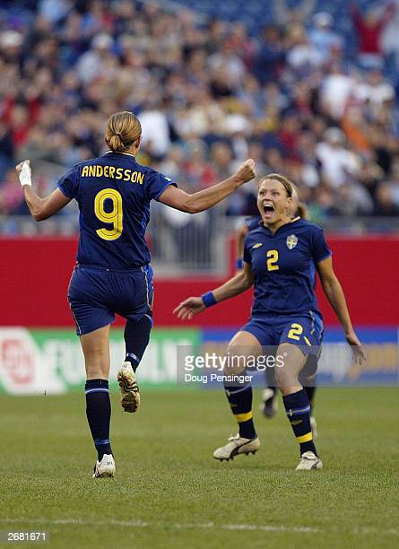 Midfielder Malin Andersson of Sweden celebrates with teammate defender Karolina Westberg after scoring from a direct free kick against Brazil during...