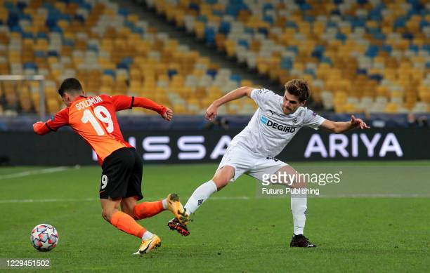 KYIV UKRAINE NOVEMBER 3 2020 Midfielder Manor Solomon of FC Shakhtar Donetsk and midfielder Jonas Hofmann of Borussia Monchengladbach are seen in...