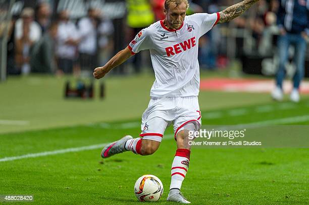 Midfielder Marcel Risse of 1FC Koeln kicking the ball at CommerzbankArena on September 12 2015 in Frankfurt am Main Germany