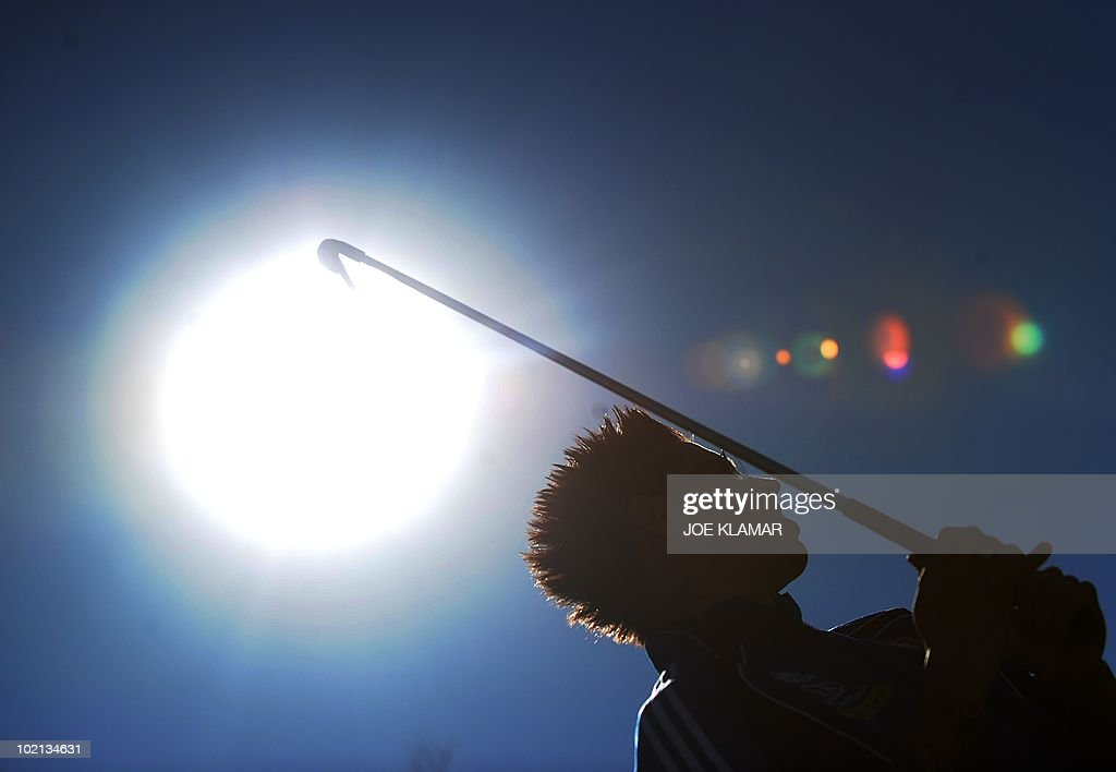Midfielder Marek Hamsik, captain of Slovakia's national football team, tees off at a golf practice range at Pretoria Coutry Club on June 16, 2010 during the 2010 World Cup football tournament in South Africa.