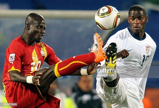 Midfielder Maurice Edu fights for the ball with Ghana's midfielder Stephen Appiah during the 2010 World Cup round of 16 football match between the...