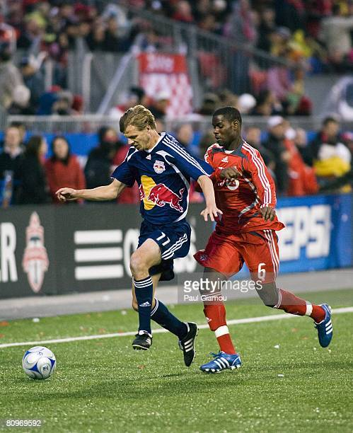 Midfielder Maurice Edu of the Toronto FC fights for the ball with midfielder Dave van den Bergh of the New York Red Bulls on May 1, 2008 at BMO Field...