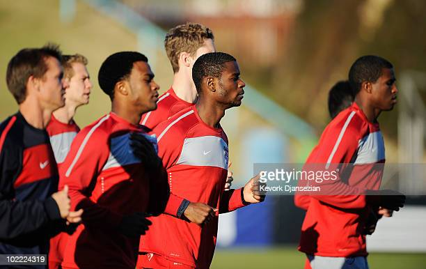 Midfielder Maurice Edu of USA sprints with his teammates during training session at Pilditch Stadium on June 19 2010 in Pretoria South Africa The USA...