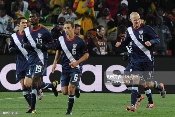 US midfielder Maurice Edu US defender Steve Cherundolo and US midfielder Michael Bradley celebrate at the end of the Group C first round 2010 World...