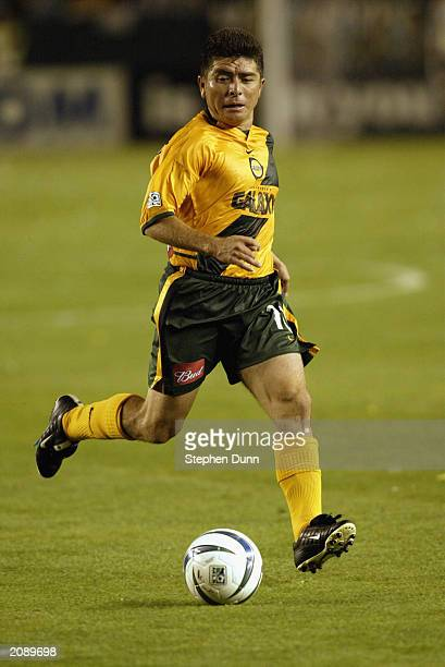 Midfielder Mauricio Cienfuegos of the Los Angeles Galaxy dribbles the ball against the Kansas City Wizards during the Major League Soccer game at the...