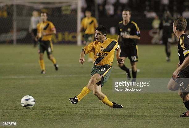 a80a949bf10 Midfielder Mauricio Cienfuegos of the Los Angeles Galaxy passes to an open  man against the Columbus