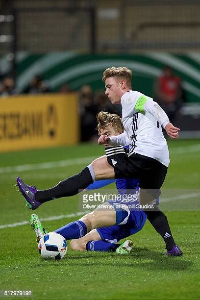 Midfielder Max Meyer of Germany and Andrias H Eriksen of Faeroer Islands fighting for the ball at Frankfurter VolksbankStadion during the...