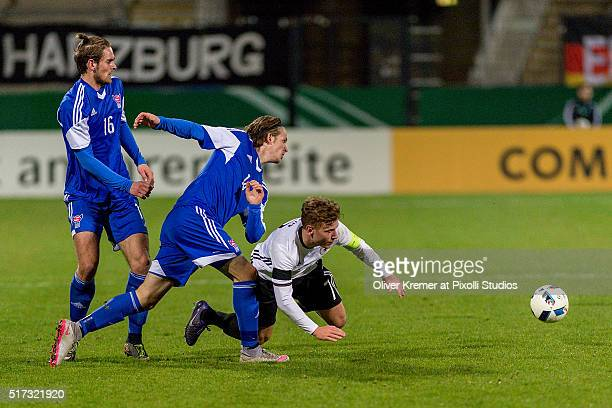 Midfielder Max Meyer of Germany is fouled by Andrias H Eriksen of Faroe Islands at Frankfurter VolksbankStadion during the international football...