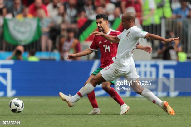 midfielder Mbark Boussoufa of Morocco National team and midfielder Joao Mario of Portugal National team during the group B match between Portugal and...
