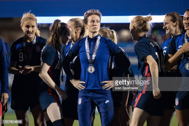 Midfielder Megan Rapinoe looks out at the crowd after receiving her championship medal during the SheBelieves Cup soccer game between the USA and...