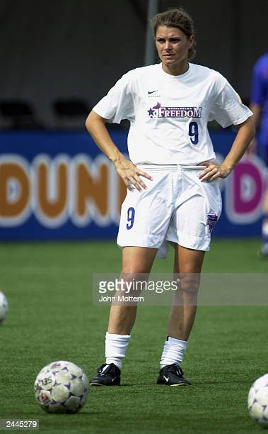 Midfielder Mia Hamm of the Washington Freedom stands on the field during warmups prior to the WUSA Semifinals game against the Boston Breakers at...