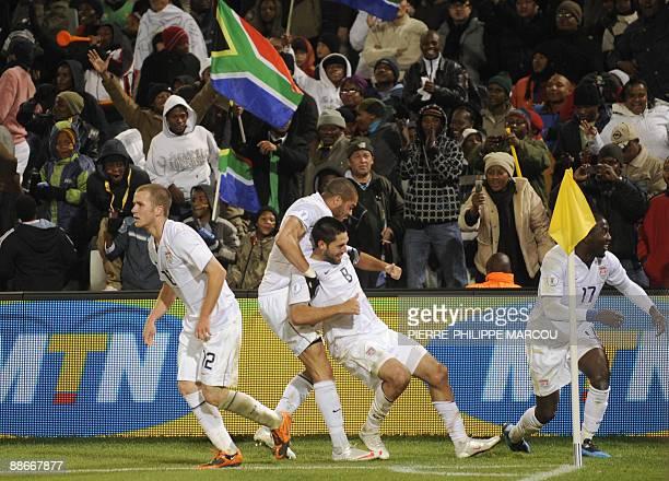US midfielder Michael Bradley US defender Oguchi Onyewu US midfielder Clint Dempsey and US forward Jozy Altidore celebrate after Dempsey scored the...