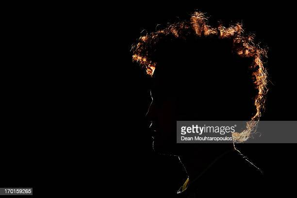 Midfielder Mustafa Amini of Australia and club team Borussia Dortmund poses during a portrait session at the BVB Training Centre on March 13 2013 in...