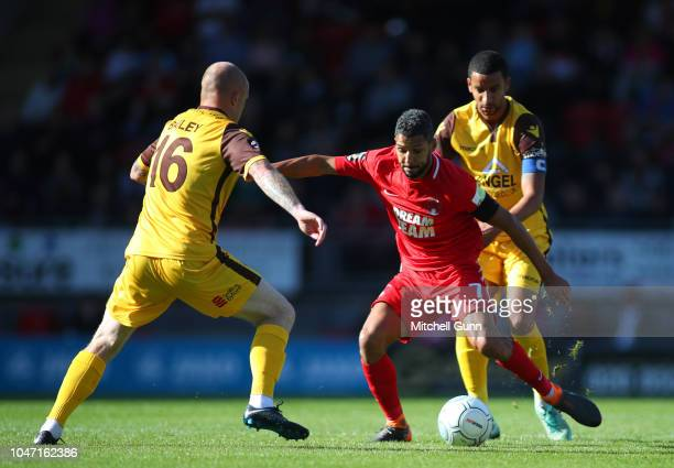 midfielder Nicky Bailey of Sutton Utd and midfielder Jobi McAnuff of Leyton Orient during the National League match between Leyton Orient and Sutton...