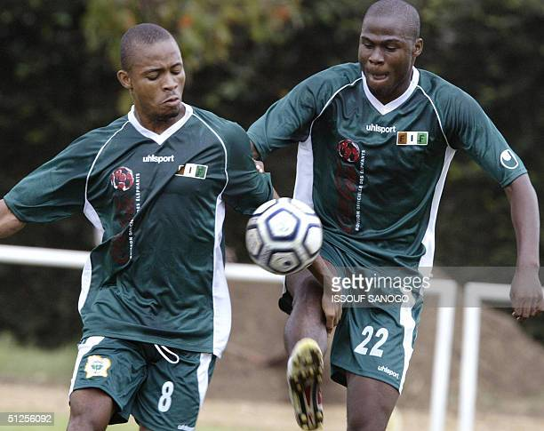 Midfielder of the Elephants Ivory Coast 's national soccer team Kalou Bonaventure and teammate Guy Damel are seen during a training session in...