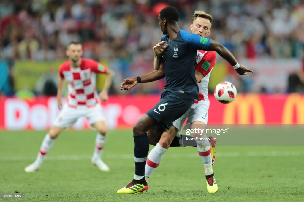 Midfielder Paul Pogba of France National team and Midfielder Ivan Rakitic of Croatia National team during the final match between France and Croatia at the FIFA World Cup on July 15, 2018 at the Luzhniki Stadium in Moscow, Russia.