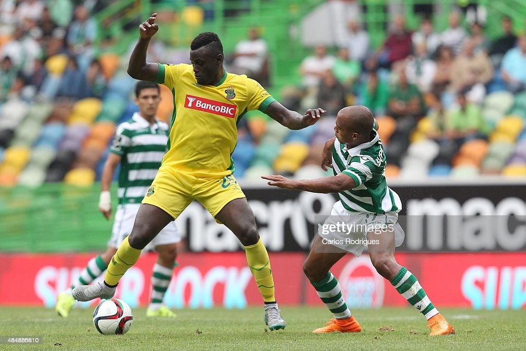 Midfielder Pele of FC Pacos de Ferreira vies with midfielder Joao Mario of Sporting CP during the match between Sporting CP and FC Pacos de Ferreira at Jose Alvalade Stadium on August 22, 2015 in Lisbon, Portugal.