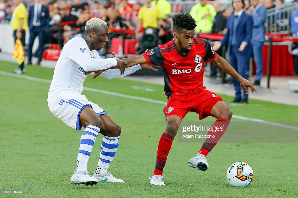 Midfielder Raheem Edwards #44 of Toronto FC fights for control of the ball as Midfielder Ballou Jean-Yves Tabla #13 of the Montreal Impact grabs his arm during Leg 2 of the 2017 Canadian Championship on June 27, 2017 at BMO Field in Toronto, Canada.