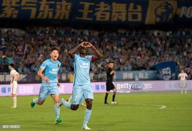 Midfielder Ramires Santos of Jiangsu FC celebrating his goal during the China Super League match between Jiangsu FC and Tianjin Quanjian FC at...