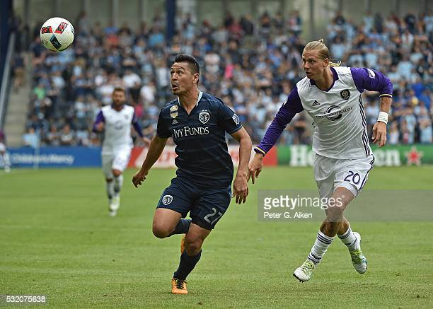Midfielder Roger Espinoza of Sporting Kansas City makes a play on the ball against forward Brek Shea of Orlando City SC during the second half on May...