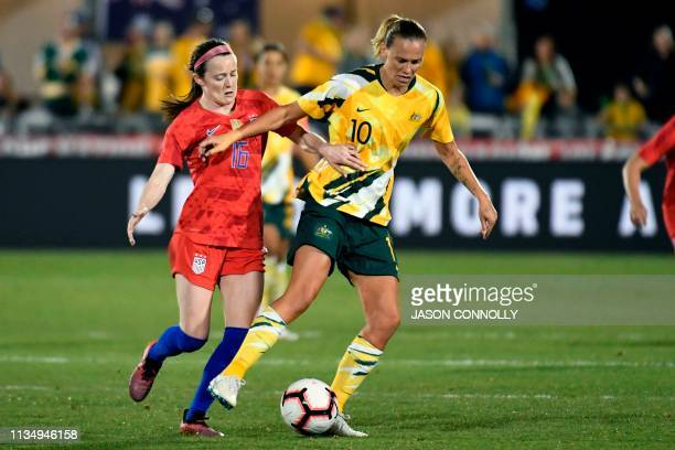 Midfielder Rose Lavelle vies for the ball with Australia's midfielder Emily van Egmond during the women's international friendly football match...