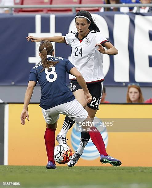 Midfielder Sara DoorsounKhajeh of Germany controls the ball against defender Jessica Houara of France during the first half of the 2016 SheBelieves...