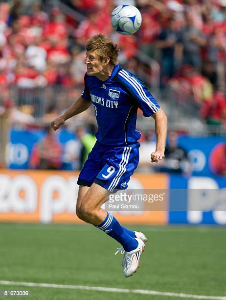 Midfielder Sasha Victorine of the Kansas City Wizards jumps for the ball during the match against Toronto FC on June 21 2008 at BMO Field in Toronto...