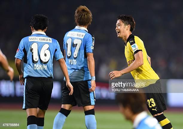 Midfielder Shinji Kagawa of Germany's football club Borussia Dortmund reacts after scoring his second goal against Japan's club Kawasaki Frontale...