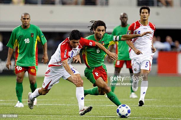 Midfielder Stephane Auvray of Guadeloupe dribbles the ball past Christian Oviedo of Costa Rica during the CONCACAF Gold Cup Quarterfinals at Dallas...